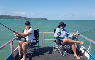 Girls fishing at West Point with Townsville Boat Hire